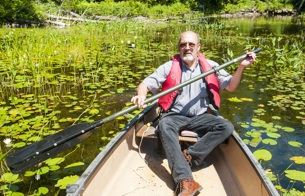 John Andrews paddles a canoe Wednesday on David Pond, which is in Fayette and Chesterville. Somethigns difromg story akdg and why we cares kg kdkg ks adkg ksadgk