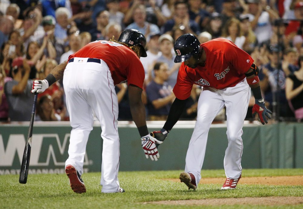 Boston's Eduardo Nunez, right, celebrates his solo home run with Hanley Ramirez in the sixth inning Friday night against the Chicago White Sox at Fenway Park.