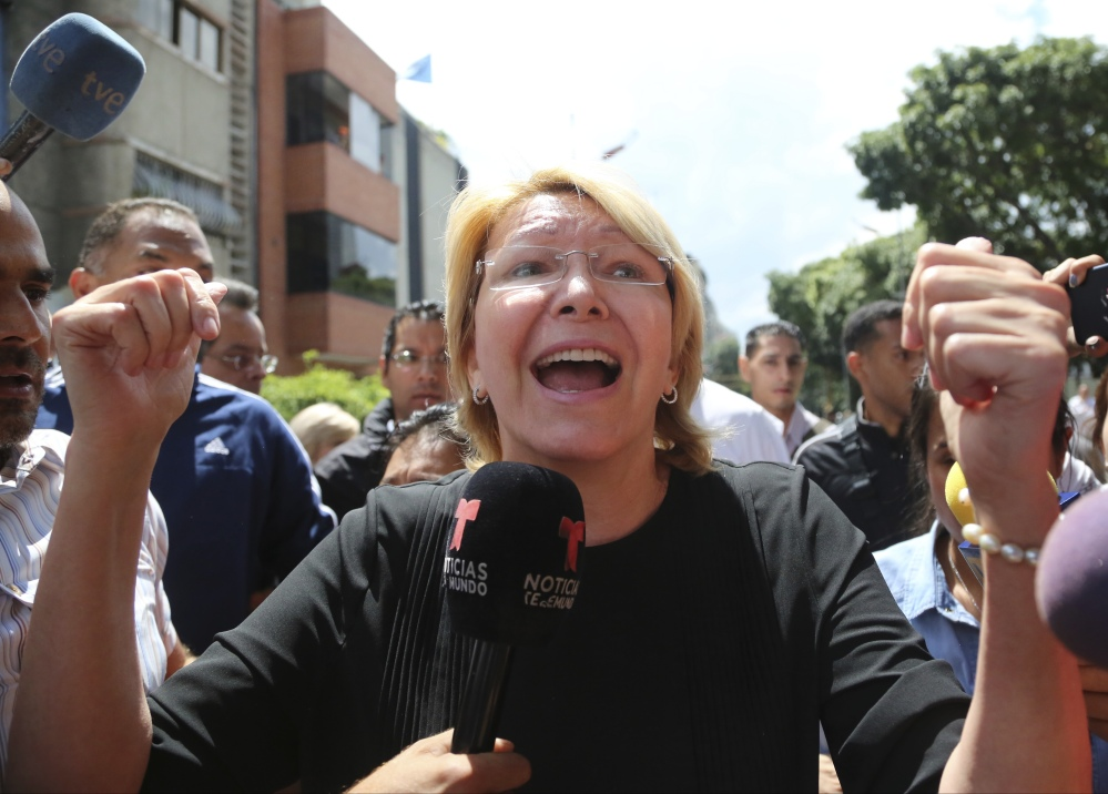 Venezuelan General Prosecutor Luisa Ortega Diaz speaks to the media outside her office. She was unanimously voted out of office and replaced with a government loyalist.