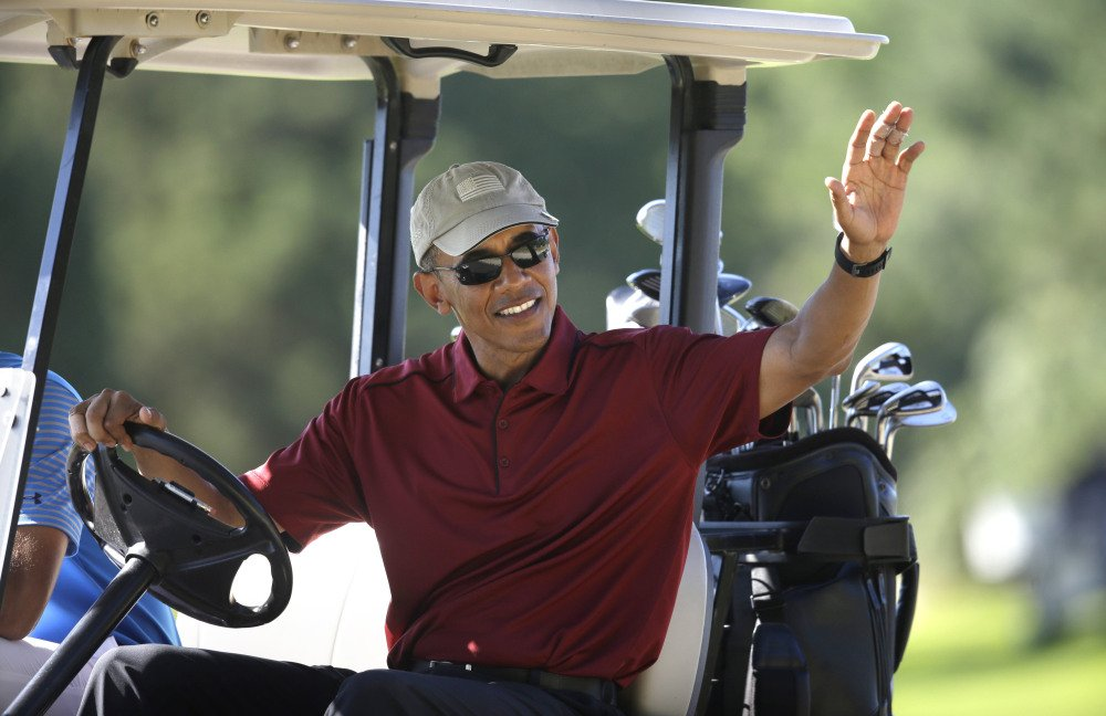 President Obama golfs at Farm Neck Golf Club during a 2015 family vacation on Martha's Vineyard in Massachusetts.