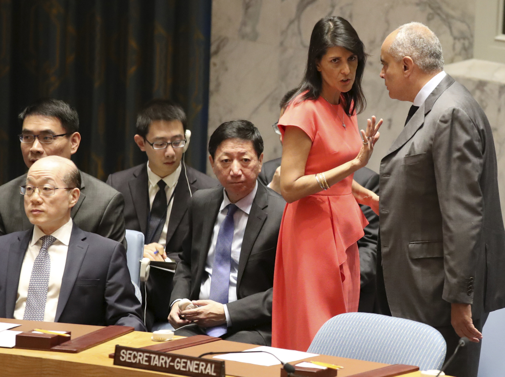 U.S. Ambassador to the United Nations Nikki Haley speaks to Egyptian Ambassador and Security Council President Amr Abdellatif Aboulatta before a vote on new sanctions to mount pressure on North Korea, pushing it to return to negotiations on its missile program.