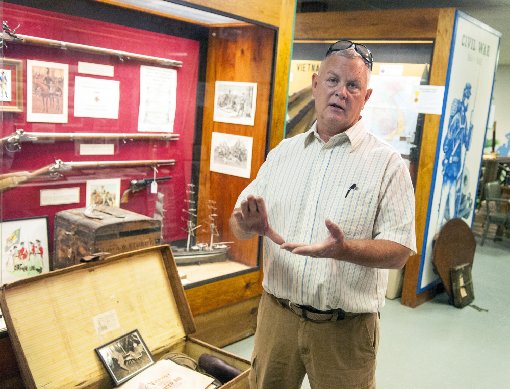 Dwaine Drummond leads a tour Thursday at the Maine Military Historical Society's museum at Camp Keyes in Augusta.