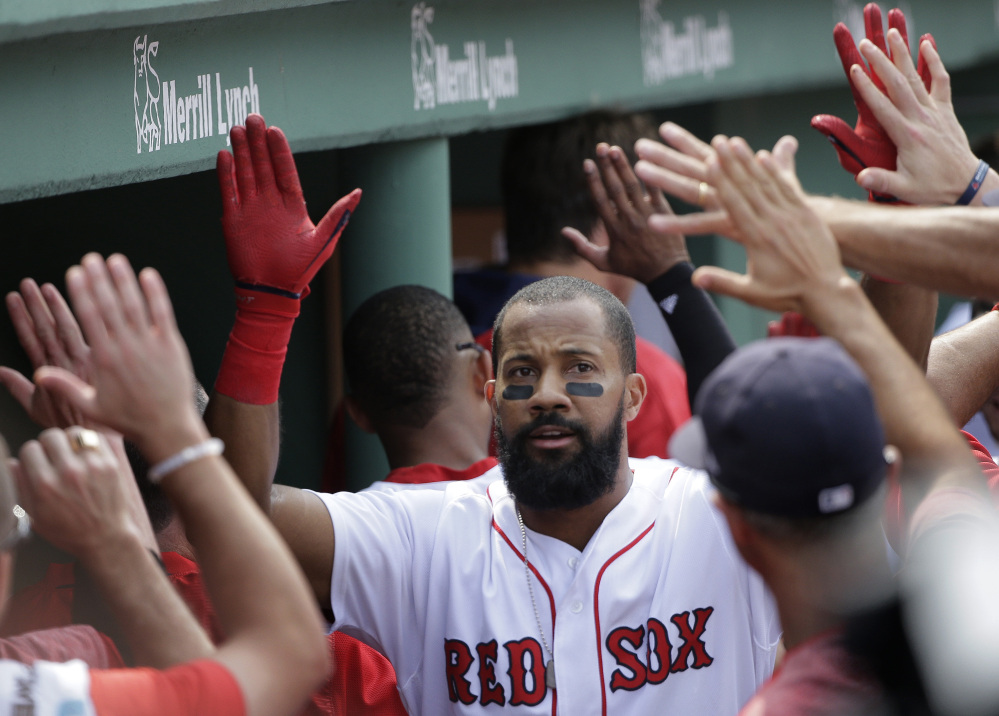 Red Sox's Chris Young is welcomed into the dugout after hitting a three-run home run off a pitch by Chicago White Sox's Mike Pelfrey in the fifth inning Sunday in Boston.