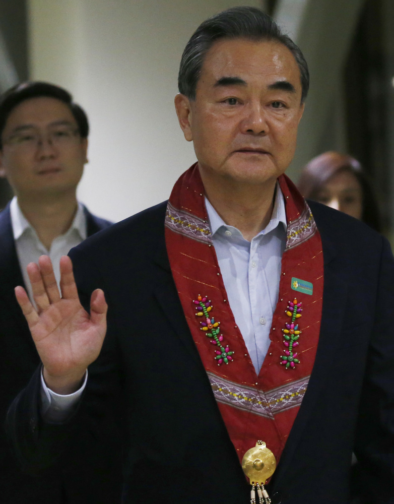 Chinese Foreign Minister Wang Yi arrives at an Association of Southeast Asian Nations meeting Saturday in Manila, Philippines. On Sunday he urged North Korea to cease missile and nuclear tests.