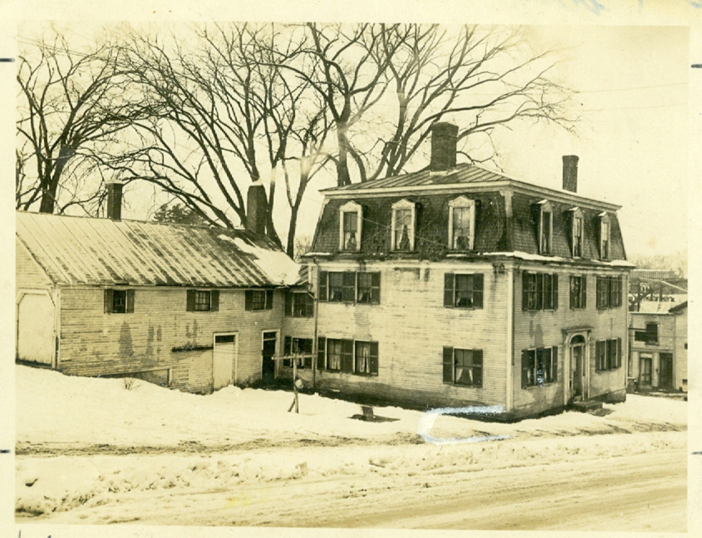 The Locke Tavern and stables, circa 1930. A February fire damaged the building, which has since been demolished.