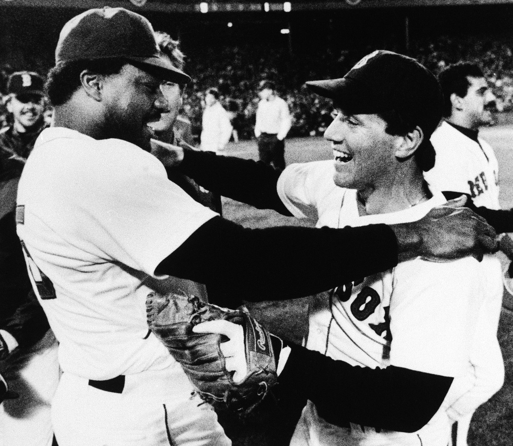 Boston Red Sox second baseman Marty Barrett, right, and designated hitter Don Baylor embrace after their team won the AL championship over the California Angels 8-1 at Fenway Park, Wednesday, Oct. 16, 1986, Boston, Mass. Barrett was named Most Valuable Player of the seven game championship series. (AP Photo/Peter Southwick)