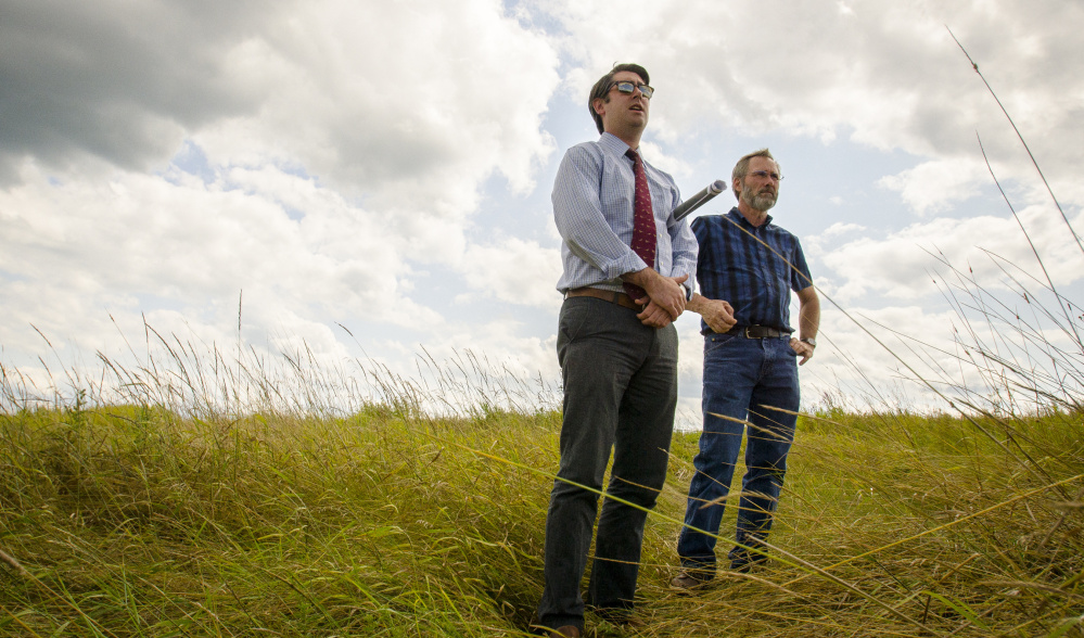 Garvan Donegan, a Central Maine Growth Council economic development specialist, left, and Greg Brown, Waterville city engineer, survey a landfill off Webb Road. The city plans to use the site for a solar array that could power 3,750 homes.