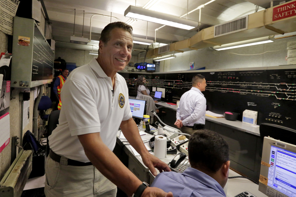 New York Gov. Andrew Cuomo visits the subway control room under the Columbus Circle subway station in New York, durning a media tour, Wednesday, Aug. 9, 2017.  Cuomo on Wednesday promised that the system's power provider, Con Edison, is now working with the Metropolitan Transportation Authority, which runs the subway system, on fixes and upgrades that will reduce delays substantially. (AP Photo/Richard Drew)