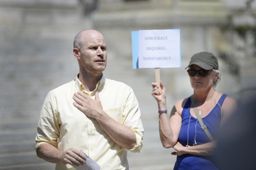 """Jack O'Brien, a member of Fair Rent Portland, speaks at a rally Wednesday at City Hall. On Thursday, he said, """"We're excited that the city has found a potential solution"""" to a technical error that could keep two citizens initiatives off the city's November ballot."""