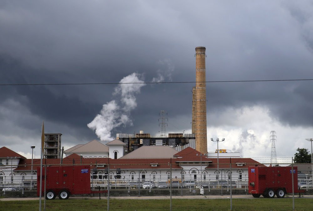 Clouds gather over the New Orleans Sewerage & Water Board facility, where turbines that power pumps have failed. Gov. John Bel Edwards declared a state of emergency Thursday in New Orleans, where some neighborhoods are at greater risk of  flooding.