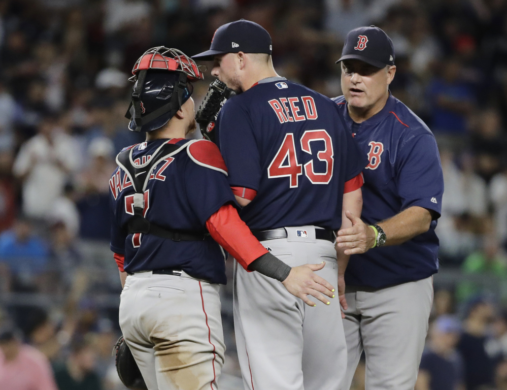 Red Sox manager John Farrell takes relief pitcher Addison Reed out of the game in the eighth inning, which proved disastrous for Boston. Reed failed to get anyone out and a 3-0 lead vanished.