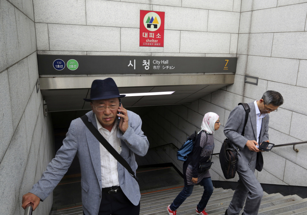 A shelter sign is displayed in case of a possible North Korean attack at the entrance to a subway station in Seoul, South Korea, on Saturday.