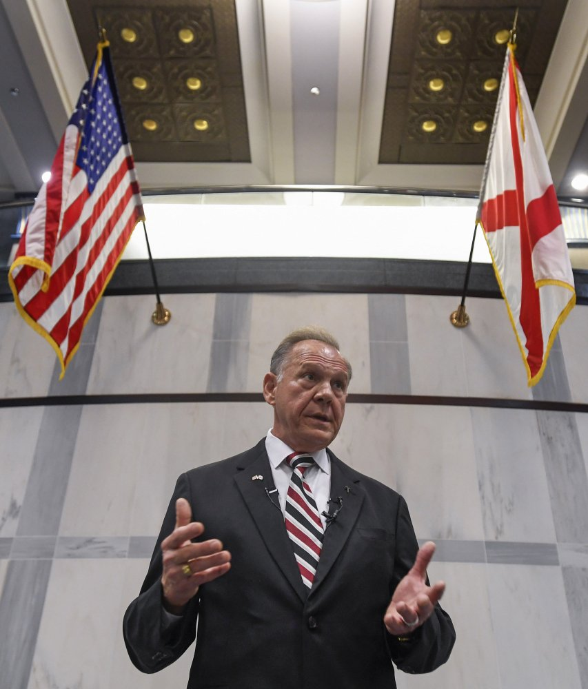 FILE - In this Wednesday, Aug. 9, 2017, file photo, U.S. Senate candidate Roy Moore holds a press conference in Montgomery, Ala. In the Alabama race for Attorney General Jeff Sessions' former Senate seat, the Republican slugfest primary is about love of all things Trump, with contenders openly wooing Trump voters, and hatred of the so-called swamp of Washington D.C. Sen. Luther Strange, who was appointed to the position in February, is trying to fight off a field of firebrand challengers, including U.S. Rep. Mo Brooks and Moore in the GOP primary. (Mickey Welsh/The Montgomery Advertiser via AP, File)