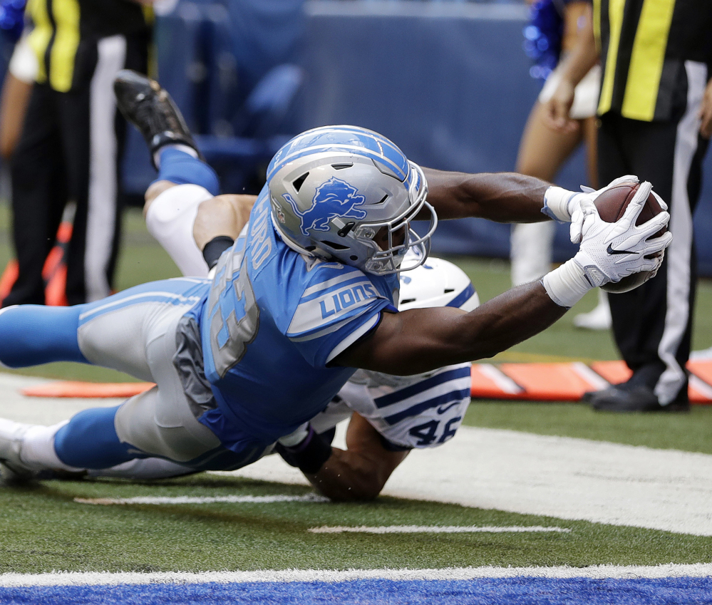 Dontez Ford of the Lions stretches for the end zone to complete a 15-yard touchdown reception Sunday in a preseason game against the Indianapolis Colts. The Lions won, 24-10.