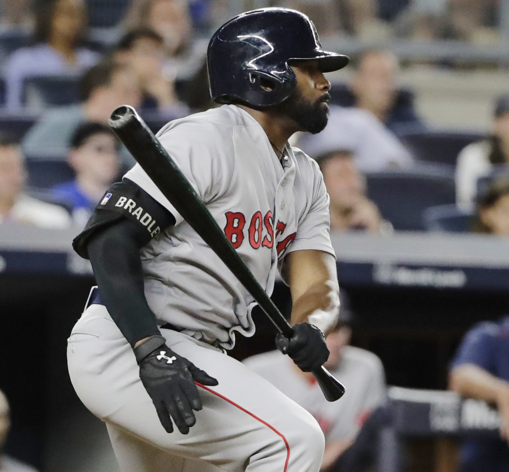 Jackie Bradley Jr. hits an RBI single in the fifth inning Sunday night against the Yankees. Bradley later scored the winning run in the 10th inning.