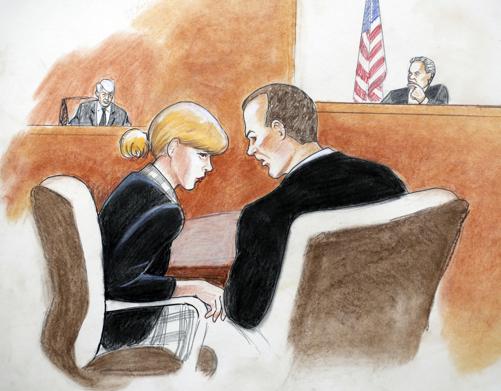 A courtroom sketch shows pop singer-songwriter Taylor Swift conferring with attorney Douglas Baldridge during her trial in Denver.