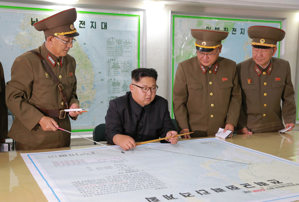 """North Korean leader Kim Jong Un, center, talks with military commanders during his visit to Korean People's Army's Strategic Forces in North Korea. The Korean Central News Agency said Tuesday that Kim, during an inspection of the KPA's Strategic Forces, praised the military for drawing up a """"close and careful"""" plan."""
