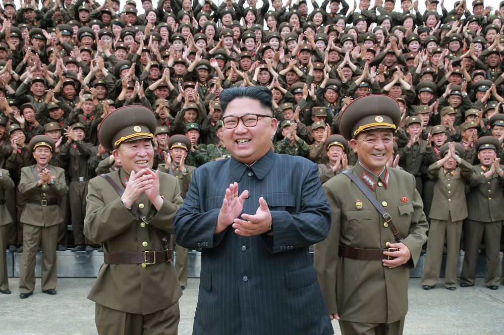 """Kim Jong Un acknowledges a welcome from the military officers during his visit to Korean People's Army's Strategic Forces in North Korea. Kim said he will give the order for a missile test near Guam if the United States continues its """"extremely dangerous actions"""" on the Korean Peninsula."""