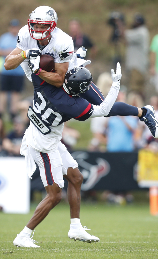 This weekend, they may do it in a game, but on Tuesday it was practice as Chris Hogan of the Patriots was upended by Kevin Johnson of the Texans.