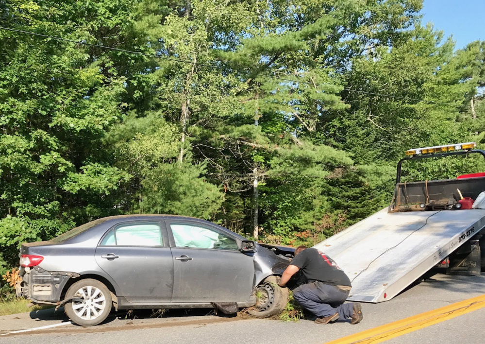 This Toyota Corolla was destroyed Wednesday when it spun off Route 137 and crashed among trees. Police are stepping up patrols on the road to try to avert such accidents.