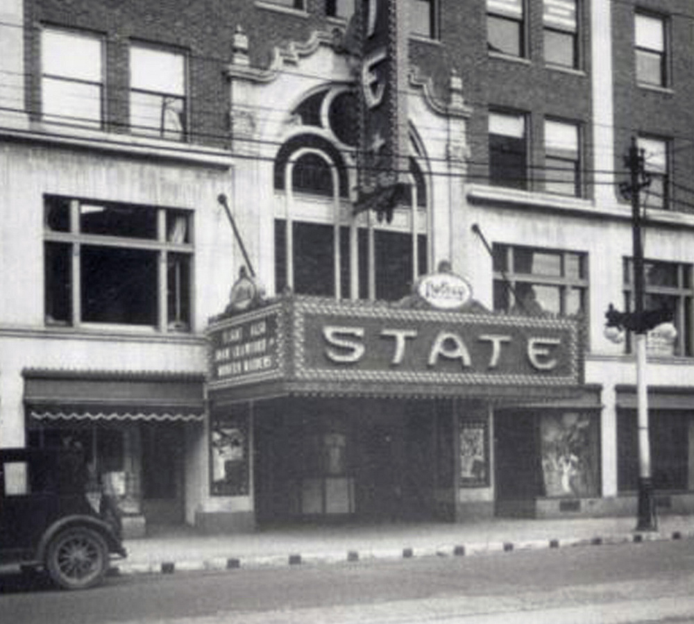 The State Theatre at Congress and High streets in Portland is shown in 1930, shortly after it opened in 1929. The light bulbs that adorned the marquee will be restored so that it again will be lit up at night.