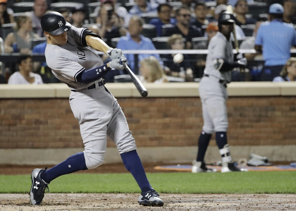 Aaron Judge of the Yankees homers during the fourth inning of Wednesday's game against the New York Mets. Didi Gregorius also homered as the Yankees won, 5-3.
