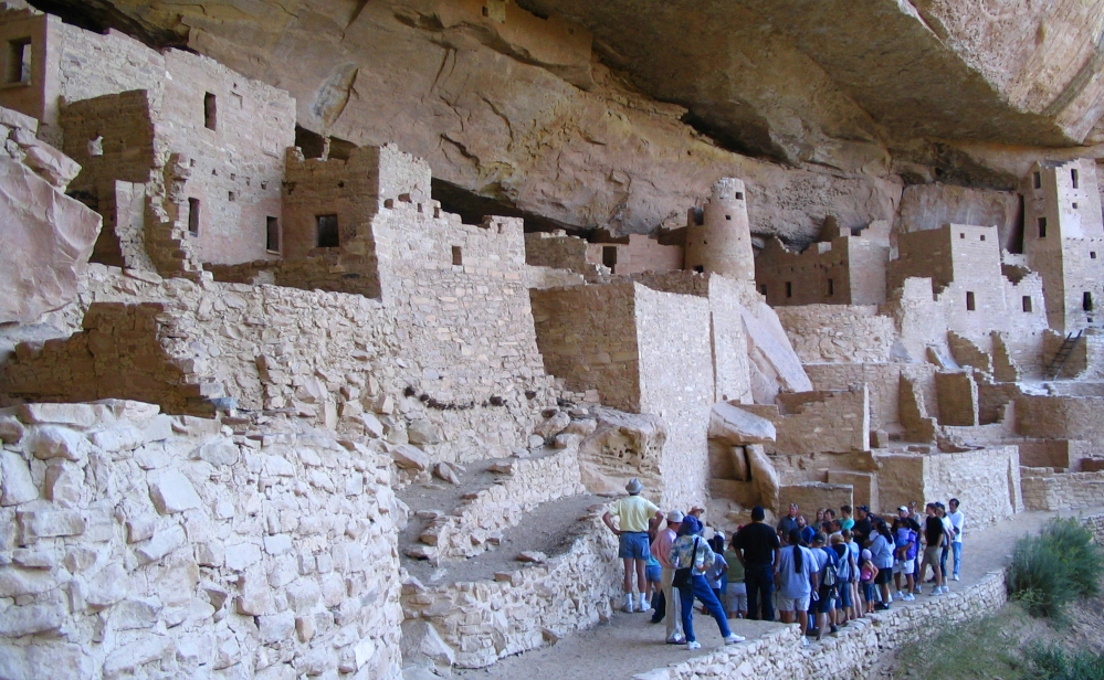 Visitors tour Cliff Palace, an ancient cliff dwelling in Mesa Verde National Park, Colo. Researchers say turkey DNA may be the key to the Pueblo people who disappeared from Mesa Verde of southwestern Colorado 700 years ago.