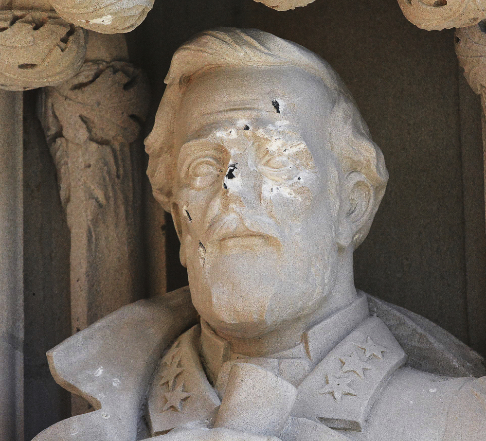 The defaced Gen. Robert E. Lee statue stands at the Duke Chapel in Durham, N.C. Duke President Vincent E. Price said he was discussing how to deal with reactions to the statue.
