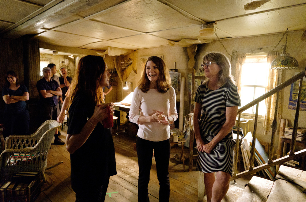 "Actress Brie Larson, left, who plays author Jeanette Walls, talks to Walls, center, on the set of ""The Glass Castle."""