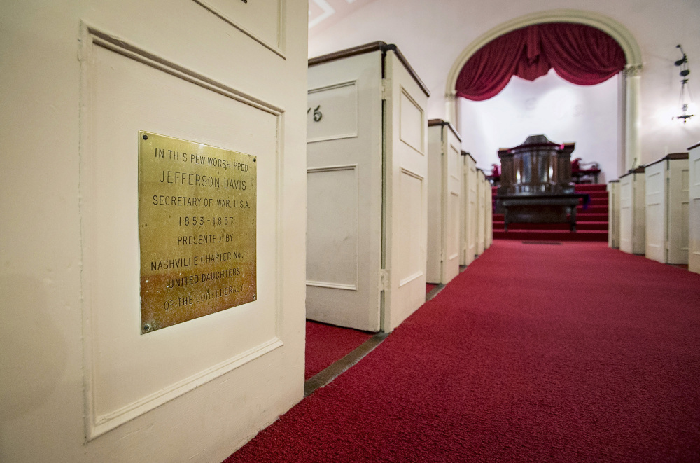A plaque commemorating a visit to Portland by Jefferson Davis is seen Friday at the First Parish Church.