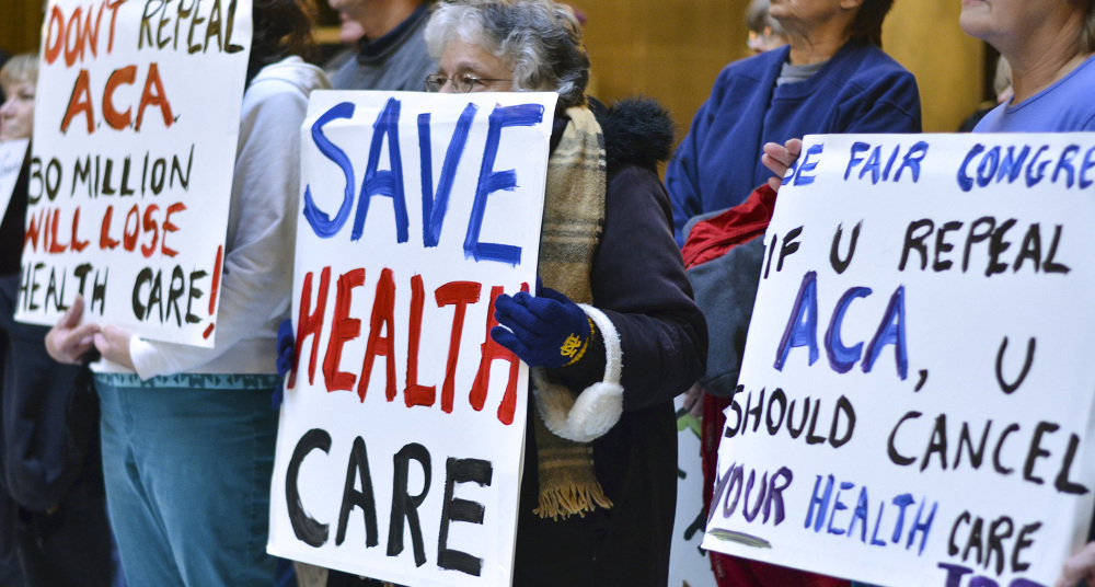People attend a health care rally at the Indiana Statehouse in support of the Affordable Care Act on Jan. 15. Having failed to repeal the law, the Trump administration is attempting to undermine it.