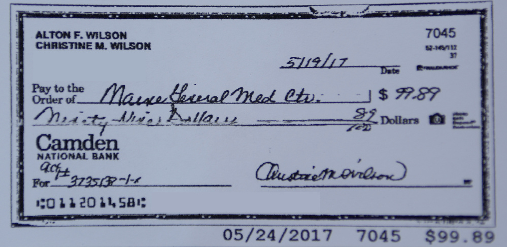 A copy of a check sent to MaineGeneral Medical Center that has been edited to block out identifying information is shown in this photo taken on Wednesday.