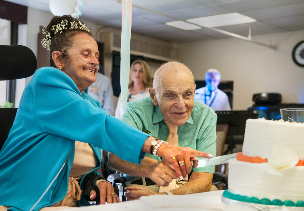 The happy couple, Sonya Trott and Bryant Brunye, enjoy their wedding cake after exchanging vows Saturday afternoon at MaineGeneral's rehabilitation and long-term care facility in Augusta.