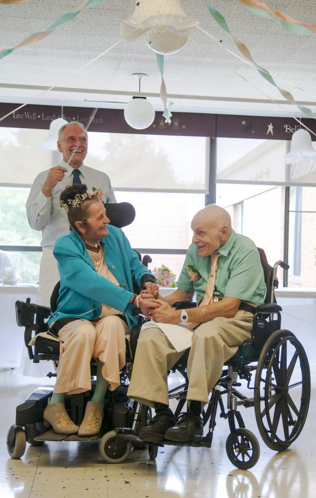 """The bride's brother, Don Trott, shakes confetti Saturday upon Sonya Trott and Bryant Brunye, who made history as the first Gray Birch residents to marry. """"It's the happiest day of my life,"""" the 75-year-old bride said."""