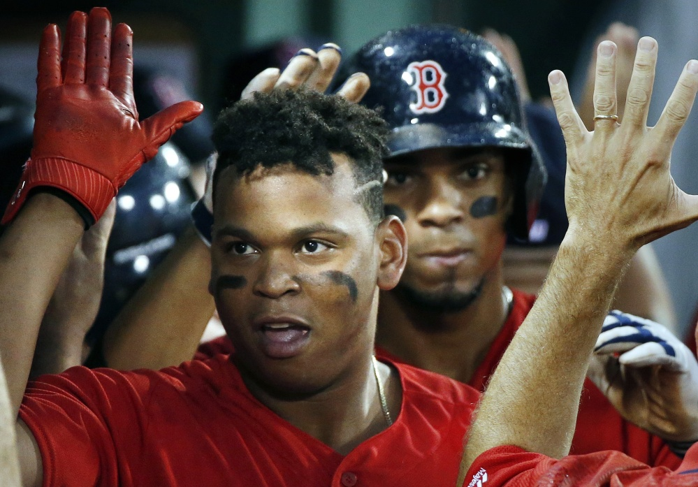Rafael Devers celebrates his two-run homer Friday night against the New York Yankees. Devers, 20, went into Saturday night's game with seven home runs and a .356 batting average in his first 19 games for the Red Sox.