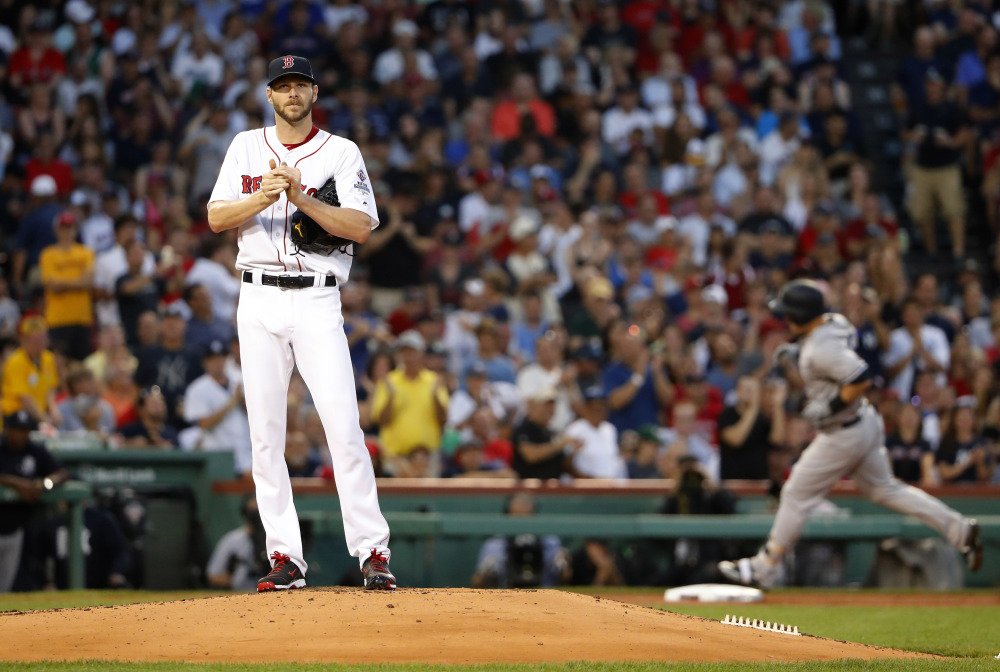 Boston starting pitcher Chris Sale stands on the mound as Tyler Austin of the Yankees rounds the bases after his three-run home run during the second inning of a baseball game at Fenway Park in Boston Saturday, Aug. 19, 2017.