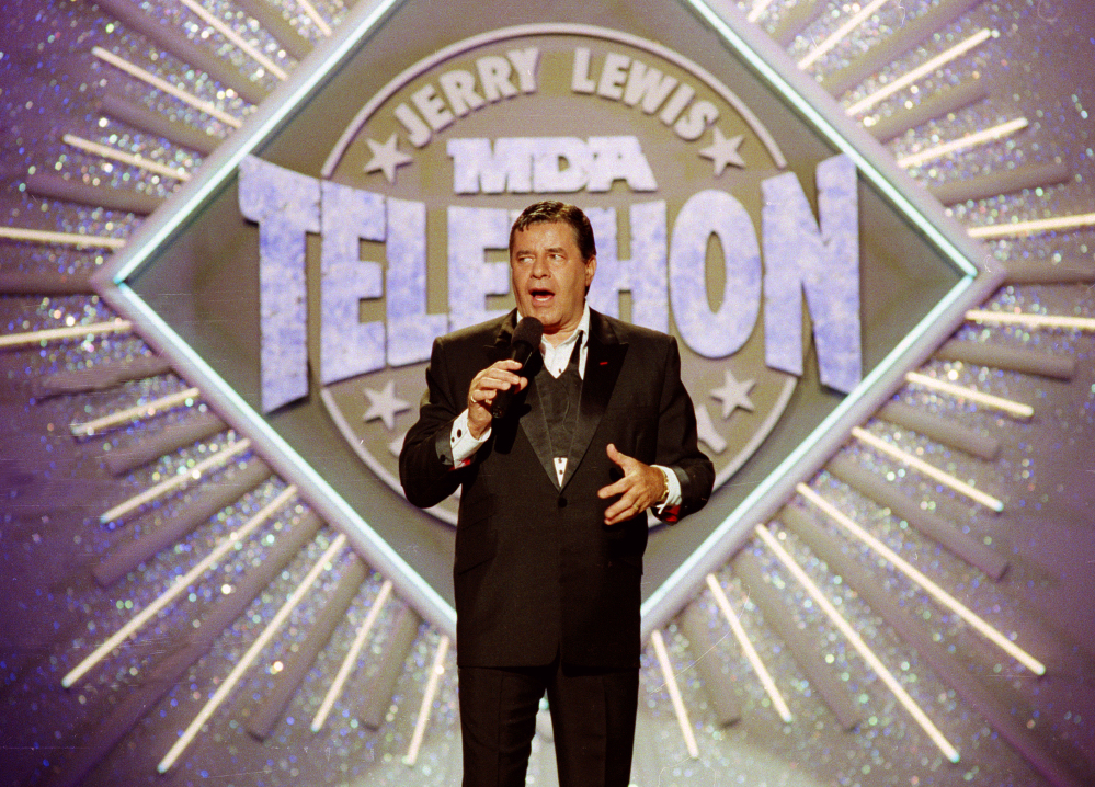 Entertainer Jerry Lewis makes his opening remarks at the 25th anniversary of the Jerry Lewis MDA Labor Day Telethon fundraiser in Los Angeles in 1990. Lewis, the comedian whose fundraising telethons became as famous as his hit movies, has died at 91.