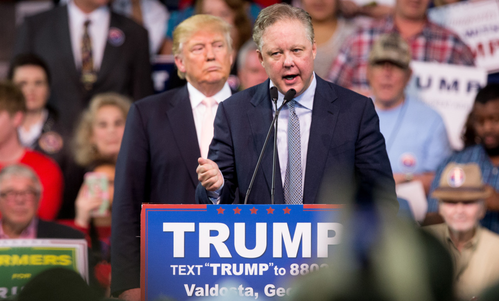 NASCAR Chairman and CEO Brian France, right, supported Donald Trump in his bid to become president, but hasn't commented about the white nationalist rally in Virginia.