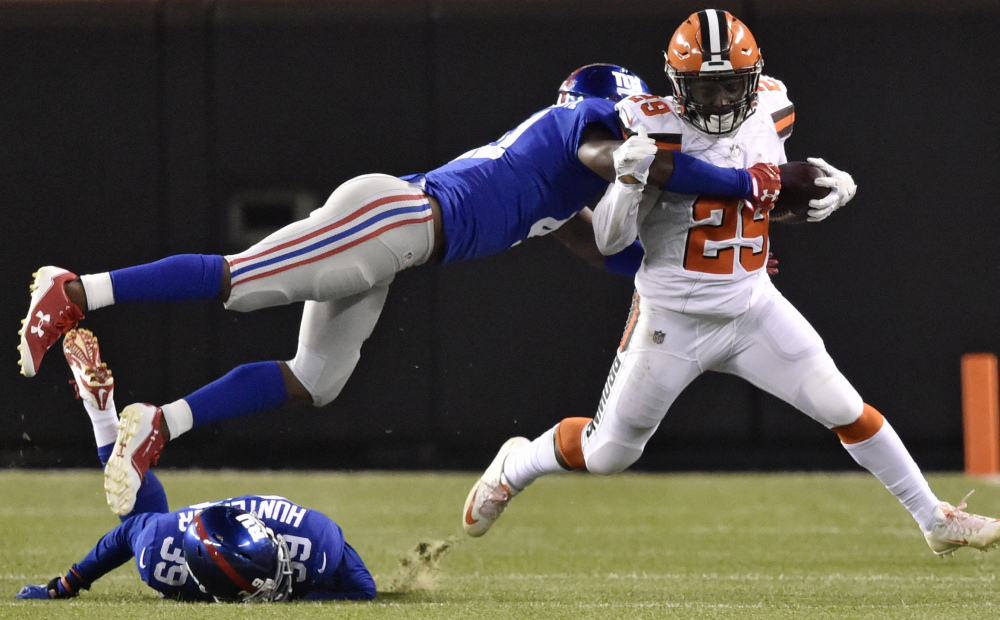 Cleveland running back Duke Johnson tries to break a tackle by Giants cornerback Dominique Rodgers-Cromartie in the first half of a preseason game Monday in Cleveland. Johnson rushed for 28 yards in the Browns' 10-6 win.