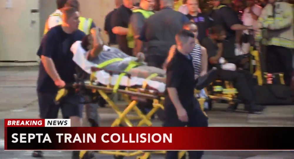 A victim is wheeled away from the scene of a train crash in Upper Darby, Pennsylvania, on Tuesday, when a commuter train crashed into a parked train at the suburban Philadelphia terminal.