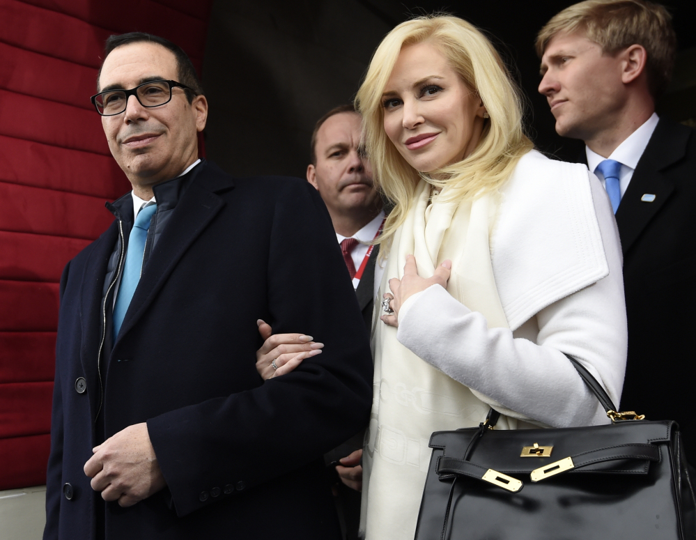 """Then Treasury Secretary-designate Stephen Mnuchin and his then-fiancee, Louise Linton, are shown in Washington in January. Linton offered a condescending response to a social media critic Monday, telling a mother of three that that she was """"adorably out of touch."""" Mnuchin and Linton were married in June."""
