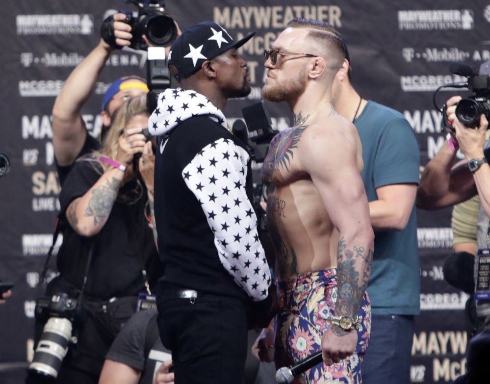 The very nature of Saturday night's matchup in Las Vegas between boxing great Floyd Mayweather Jr., left, and UFC standout Conor McGregor has promoters hoping it will be seen by as many as 50 million people.