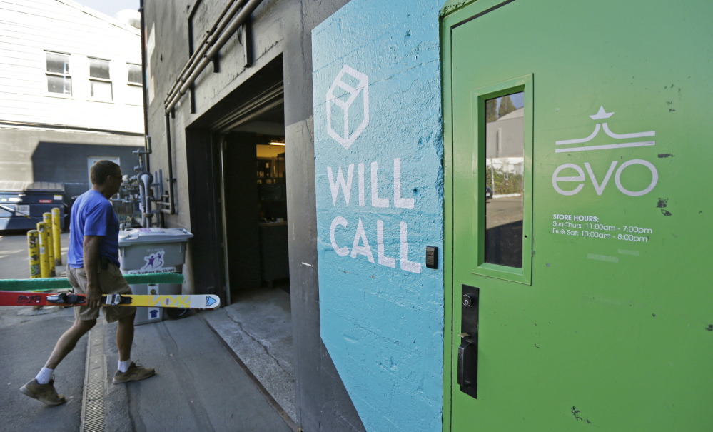 A man walks into the will-call department of evo in Seattle last month. The independent retailer also offers services like travel planning for customers who want to go on snowboarding, surfing or other outdoor sports-focused vacations.