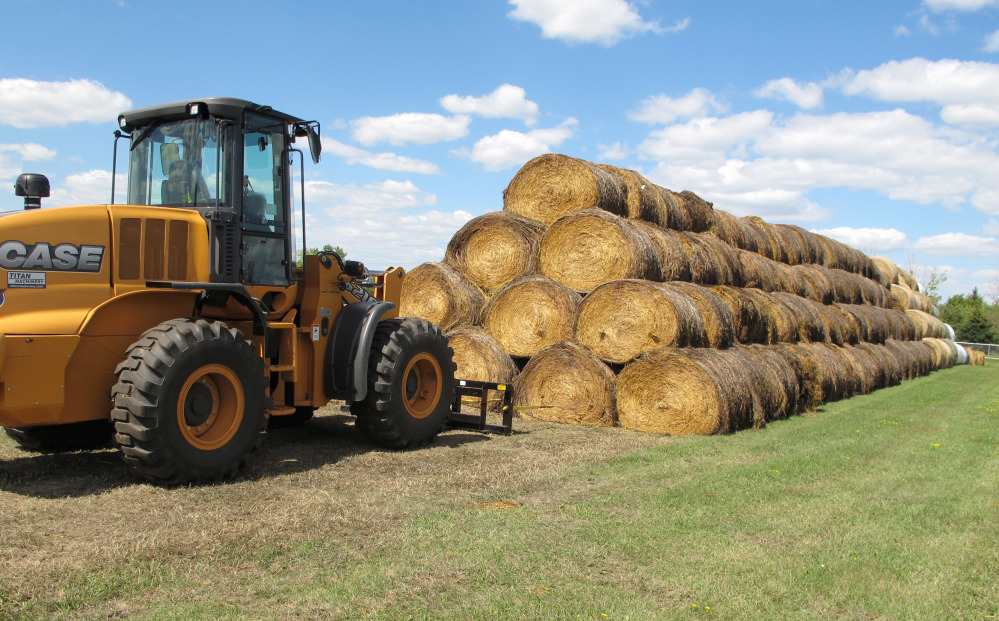 Bales of hay that have been donated for a lottery drawing to help drought-stricken farmers and ranchers are stacked Tuesday at a site near the North Dakota State University campus in Fargo. About 900 ranchers in the Dakotas and Montana have applied for the hay lottery.