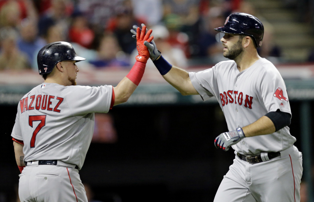 Boston's Mitch Moreland, right, is congratulated by Christian Vazquez after hitting a solo home run off Cleveland starter Corey Kluber and giving the Red Sox a 1-0 lead in the fifth inning.