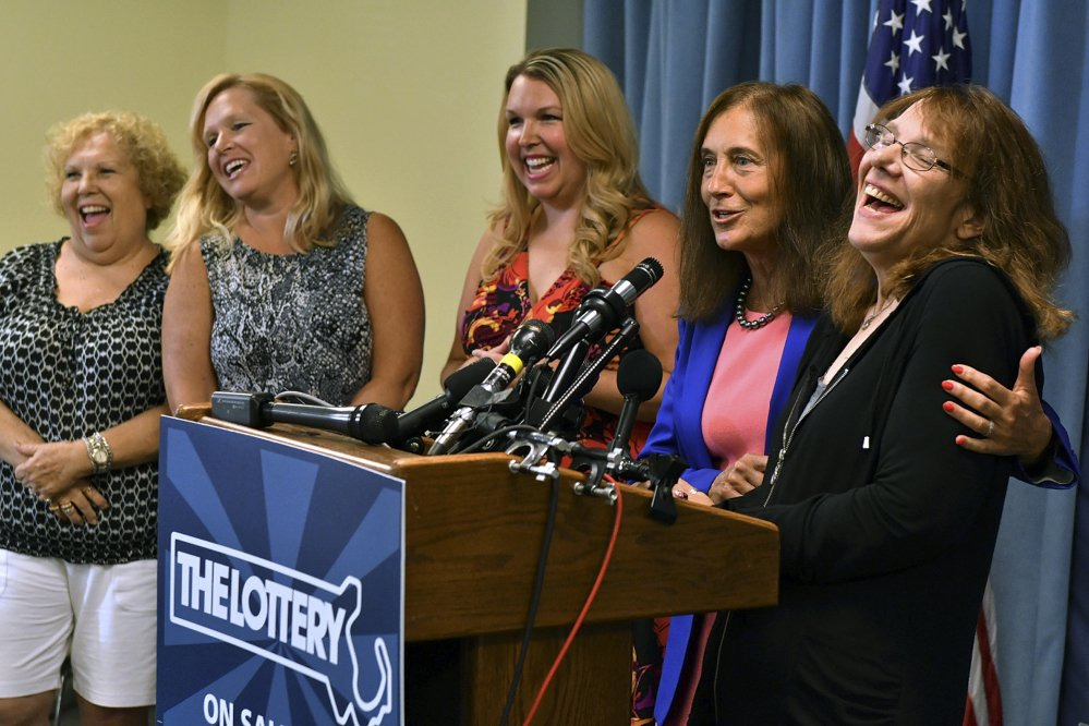 Mavis Wanczyk, right, of Chicopee, Mass., laughs beside state Treasurer Deb Goldberg during a news conference where she claimed the $758.7 million Powerball prize at Massachusetts State Lottery headquarters on Thursday in Braintree, Mass. At left are Wancyk's mother and two sisters.