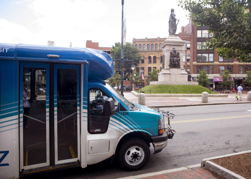 The Metro Breez bus stops in Monument Square in June. The Greater Portland Transit Service has dropped the Breez's Falmouth loop and added a Portland-Brunswick route that stops in Yarmouth and Freeport.