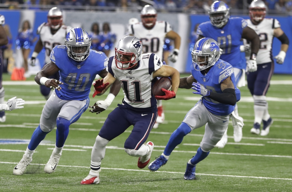 Patriots wide receiver Julian Edelman breaks downfield as Lions linebacker Jarrad Davis, left, and cornerback Darius Slay give chase during a preseason game Friday night. Edelman caught three passes on New England's opening touchdown drive but left the game with a knee injury.