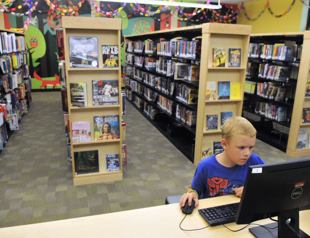 Wesley Jordan, 10, plays Minecraft on a computer in the children's area of the Lithgow Public Library on Aug. 18 in Augusta.