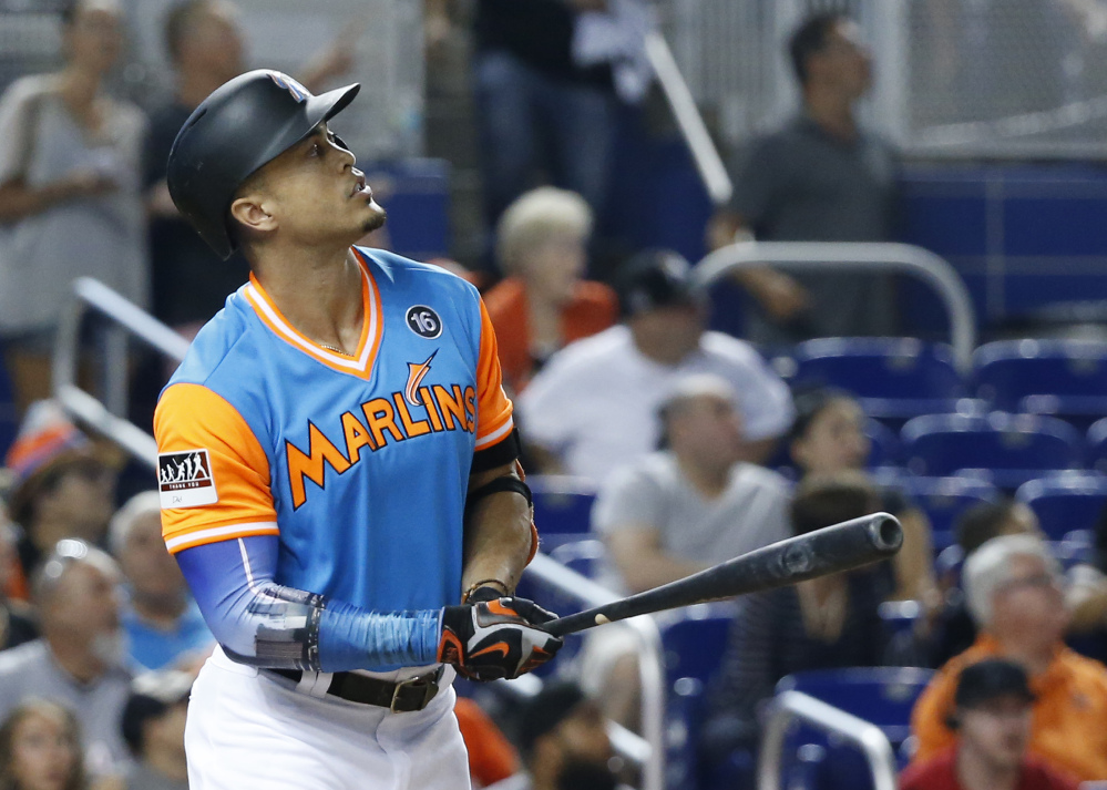 Giancarlo Stanton of the Marlins watches his two-run home run during the first inning Friday night against San Diego. Stanton added another homer in the third, his 49th of the season.